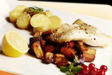 Grilled zander fillet  served with fresh potatoes and fries