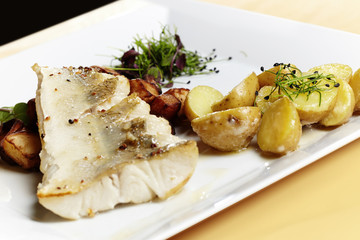 Grilled zander fillet  served with fresh potatoes