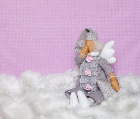 nightlight Handmade doll sits on clouds