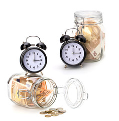Money accumulation concept. Money and alarm clock isolated on wh
