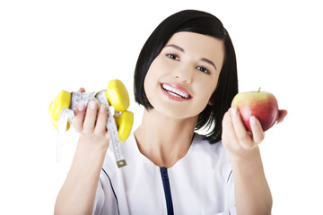 Nutritionist holding lifts and apple