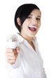 Businesswoman holding a bulb
