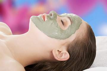 Woman in spa with a mask on her face