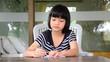 Young girl writing doing homework for school. HD
