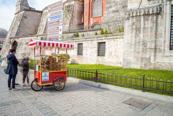 ISTANBUL, TURKEY - SEP 15: Fresh roasted sweet corn vendor as se