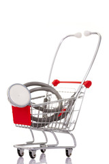Shopping cart with a stethoscope, isolated on white background