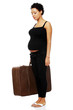 Pregnant woman with a luggage