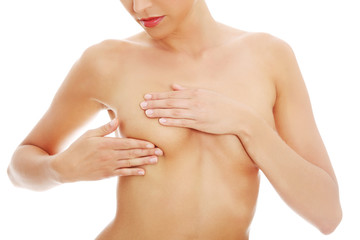 Woman examining her breast