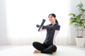 sporty asian woman exercising