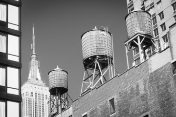 Water towers atop buildings and Empire State Building