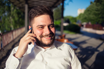 Businessman talking on the phone in a cafe