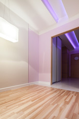 Pink room with door to the hall