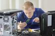 IT specialist installing ram memory
