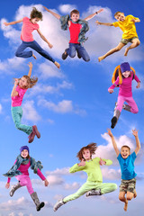 happy children exercising and jumping in the blue sky