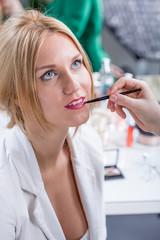 Woman during professional makeup