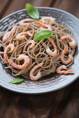 Buckwheat soba noodles with shrimps, close-up, vertical shot
