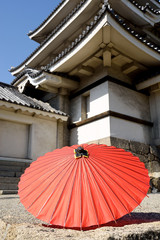 Japanese traditional red umbrella at temple