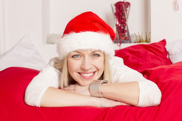girl in santa hat smiling