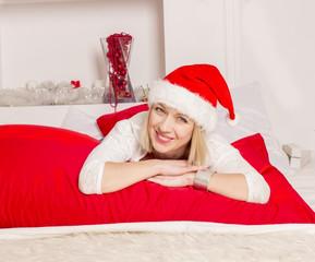 girl in santa hat smiling