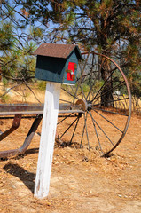 Old styled mailbox in american countryside area.