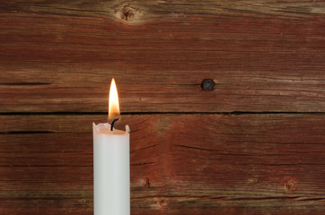 Single candlelight at old wall