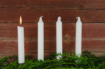 Four advent candles at an old plank wall