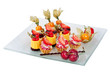 dish with mini chocolate cakes cream and berries