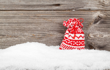 Gift Bags with winter snow on wooden boards, with copyspace