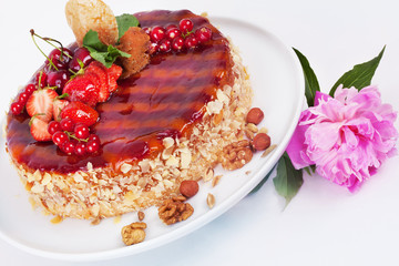 cake with strawberries currants cherries and nuts