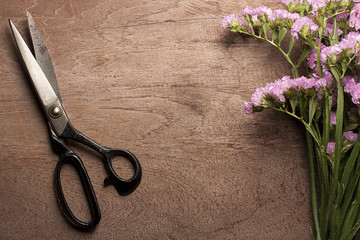 Vintage steel scissors with flower.