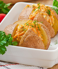 Baked potatoes stuffed with minced chicken and carrots