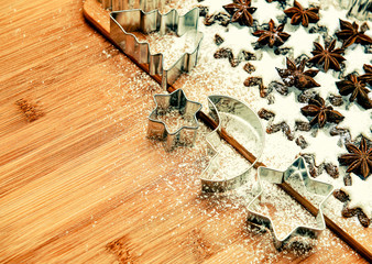 cinnamon stars and cookies cutters. vintage style toned picture