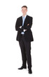 Full Length Portrait Of Confident Young Businessman