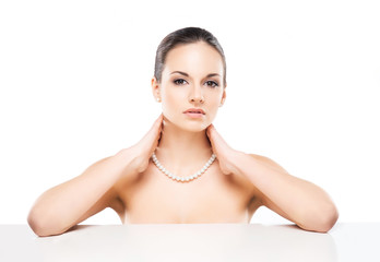 Portrait of a young and healthy woman in a pearl necklace