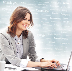 Business woman in office on a background of words