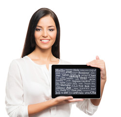 Young, successful and beautiful businesswoman with a tablet