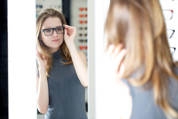 young woman at glasses store