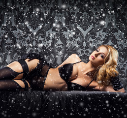 Young and beautiful cabaret dancer in sexy lingerie on the snow