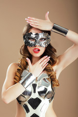 Futurism. Robotic Woman in Cosmic Mask and Metallic Costume