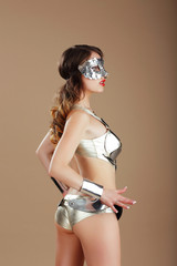 Vogue. Woman in Silver Mask and Cyber Steel Costume