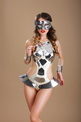 Woman in  Futuristic Glasses and Creative Metallic Costume