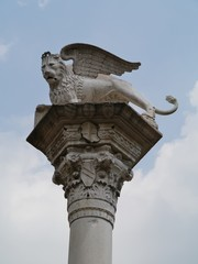 statue on a column of the lion of saint mark in Vicenza