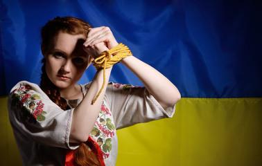 Ukrainian girl with hands tied