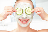 Funny young girl with a mask for skin face and cucumbers - 72451393