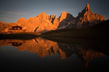 Pale di st Martino reflecting on a lake  Italian Dolomites Alps