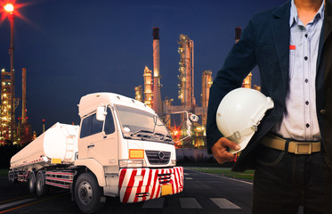engineer holding hard hat standing against beautiful lighting of