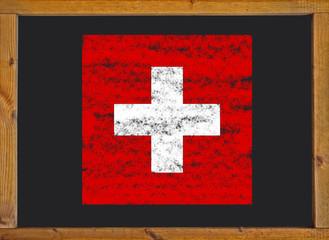 Switzerland flag on a blackboard