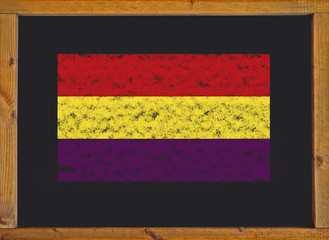 The flag of the Spanish Republic on a blackboard .