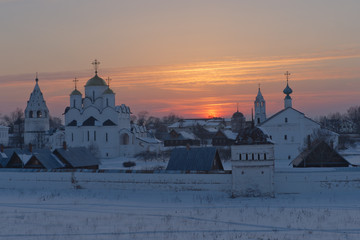 Russia. Suzdal in March. Sunset over the Pokrovsky Monastery.