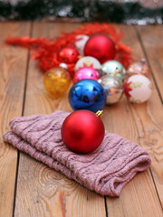 Christmas decorations with balls and woolen scarf